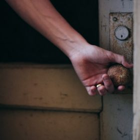 hand at a doorknob