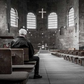 A man in an empty church