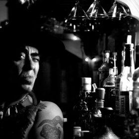 A man next to liquor