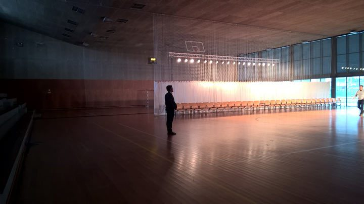 a man in a large empty hall