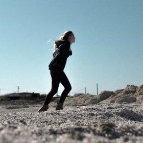 a woman walking in the wind