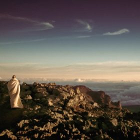 Monk on top of a mountain