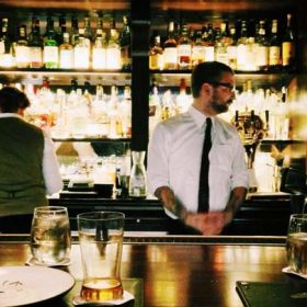 bartenders behind the counter