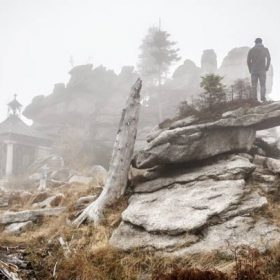 """A man in a rocky foggy landscape - imagery for """"Fetching Fossils"""" by Heath Brougher"""