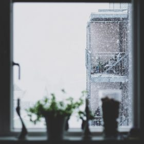 """snow outside a window - imagery for """"First & Last"""" by Ingrid Bruck"""