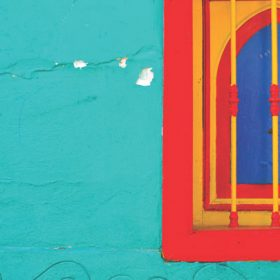 """A colorful wall with window - imagery for """"Thursday Lunch"""" by Sandra Anfang"""