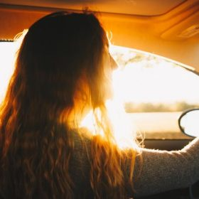 A woman in the driver's seat - imagery for the prose poem Forty-Love by Matthew Dube