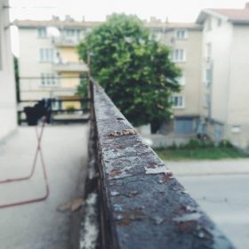 """apartment balcony overlooking street - imagery for """"Munch III"""" by Kyle Hemmings"""