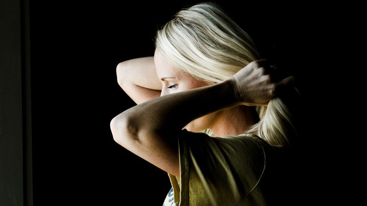"""woman pulling hair back - image for """"Let Down Your Hair"""" by Carla Kirchner"""