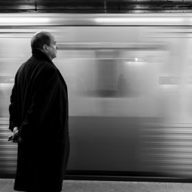 "Train by platform, image for ""Commuter, 1993"" by Kyle Potvin"