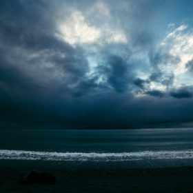 Beach under dark clouds, image for Part I by Josey Rose Duncan