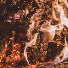 burning wood, image for After the Second Miscarriage by Marybeth Rua-Larsen