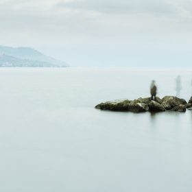 Vague figures at water's edge, image for Saltwater Tea by Thomas O'Connell