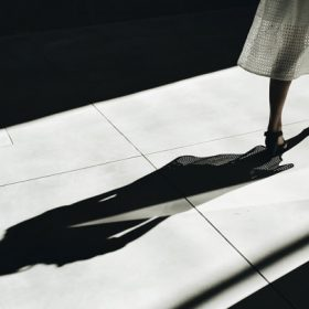 a woman's shadow, image for Division by Mark Renney