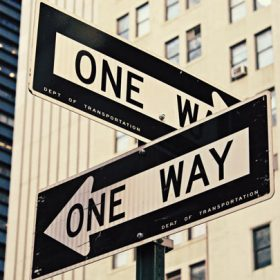 one way signs - image for Location by Iris N. Schwartz