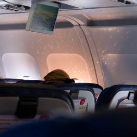 airplane interior - image for The Secret by Sandra Anfang