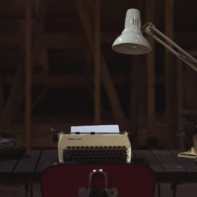 """desk with typewriter, image for """"Contributor's Note"""" by David Spicer"""