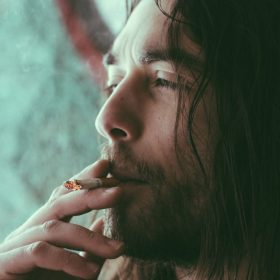 """a smoker, image for """"Quitting"""" by Greg Emilio"""