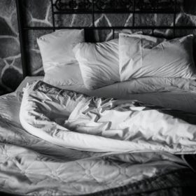 a bed, image for 'Understanding Each Other in the Dark' by Matthew Smart