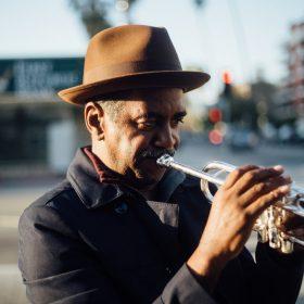 photo of man playing trumpet