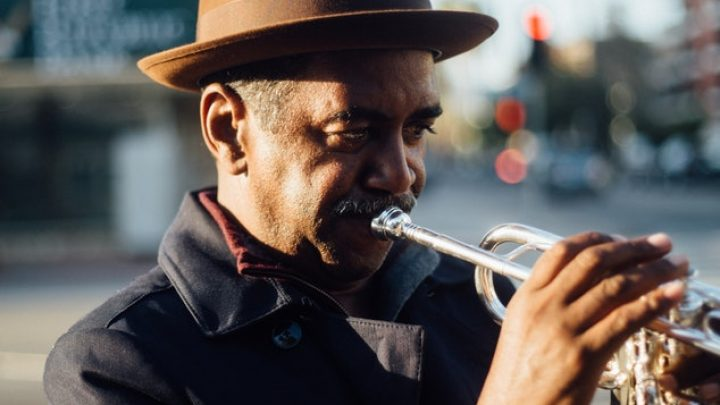 photo of man playing trumpet